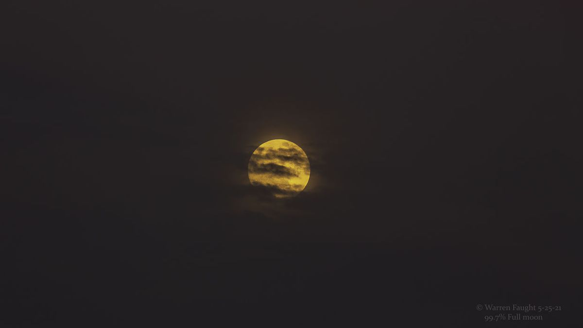 Moon passing clouds